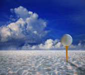 Golf ball on yellow tee and and land scape of sand desert — Stock Photo