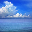 Clear blue sky white cloud and sea water - Stock Photo