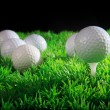 Golf ball player and green grass with equipment - Stock Photo