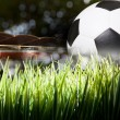 Soccer football on green grass field of stadium — Stock Photo