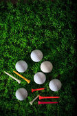Golf ball player and green grass with equipment — Stock Photo