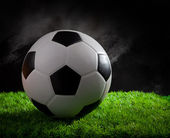 Soccer football on green grass by studio light — Foto de Stock