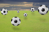 Soccer football on green grass field of stadium — Stock Photo