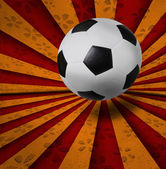 Soccer football on colorful ray background — Stock Photo
