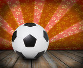Soccer football on colorful ray background — Foto de Stock