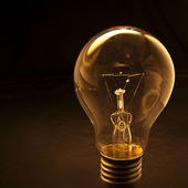 Light bulb with low key background — Stock Photo