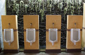 Row of urinals — Stock Photo