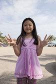 Asian girl show finger acting symbols — Stock Photo