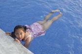 Asian girl swimming in pool — Stock Photo