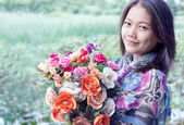 Asian woman with flower bouquet in hand — Stock Photo