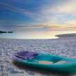 Green sea kayak on sand beach - Stock Photo