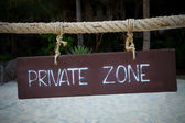 Private zone write on wood hanging rope at sea beach — Foto de Stock