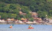 People sailing sea kayak in the sea — Stock Photo