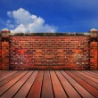 Old brick wall wood terrace with blue sky backgrund - Stock Photo