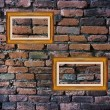 Old brick wall and picture frames — Zdjęcie stockowe