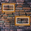Old brick wall and picture frames — Foto Stock