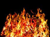 Hot fire on black — Stock Photo