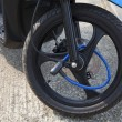 Portable lock on front wheel motocycle - Stockfoto
