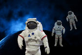 Astronauts in the space background — Stock Photo