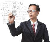 Teacher and physic formulas — Stock Photo