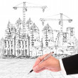 Hand writing and buiding construction - Stock Photo