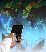 Hand and computer tablet with modern office building background — Stock Photo