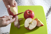 Hand sliced apples peel — Stock Photo