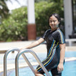 Ten years old girl playing in swimming pool — Stock Photo