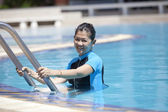 Forty years old woman in swimming pool — Stock Photo