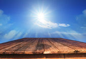 Old wood table and sun shine on blue sky — Stock Photo