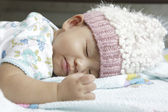 Face of baby asleeping on bed — Stock Photo