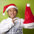 Girl holding santa claus hat — Stock Photo