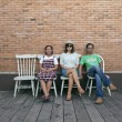 Stock Photo: Funny family on brick wall