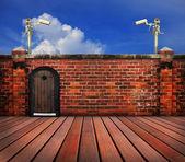 Cctv camera and old brick wall — Stock Photo