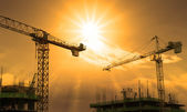 Crane and building construction — Stock Photo