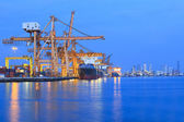 Ship yard with heavy crane in beautiful twilight of day — Foto Stock