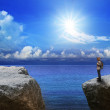 Stock Photo: Young man on rock cliff end of way