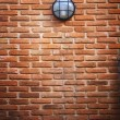 Red brick wall and light lamp — Stock Photo
