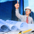 Engineer working on construction theme background — Stock Photo