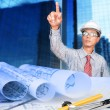 Engineer working on construction theme background — Stockfoto