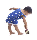 Baby painting color brush on floor isolated white background — Stock Photo