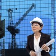 Female architect and building construction project site — Stock Photo