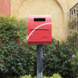 Old mail box in beautiful garden — Stock Photo