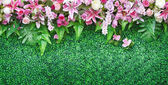 Flower bouquet on green field — Stock Photo