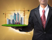 Business man and building construction — Stock Photo