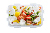 Red green yellow sweet pepper chilly in plastic box — Stock Photo