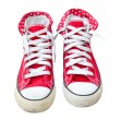 Old red sneaker isolated on white background — Stock Photo