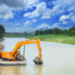 Excavator land mines from the water — Stock Photo