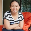 Face of asian girl toothy smiling with relaxing emotion — Stock Photo #33791419