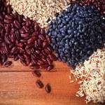 Dry grain rice food on top wood table background healthy orgaic — Stok fotoğraf